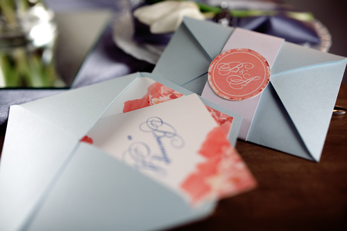 wedding invitations in envelopes on a desk